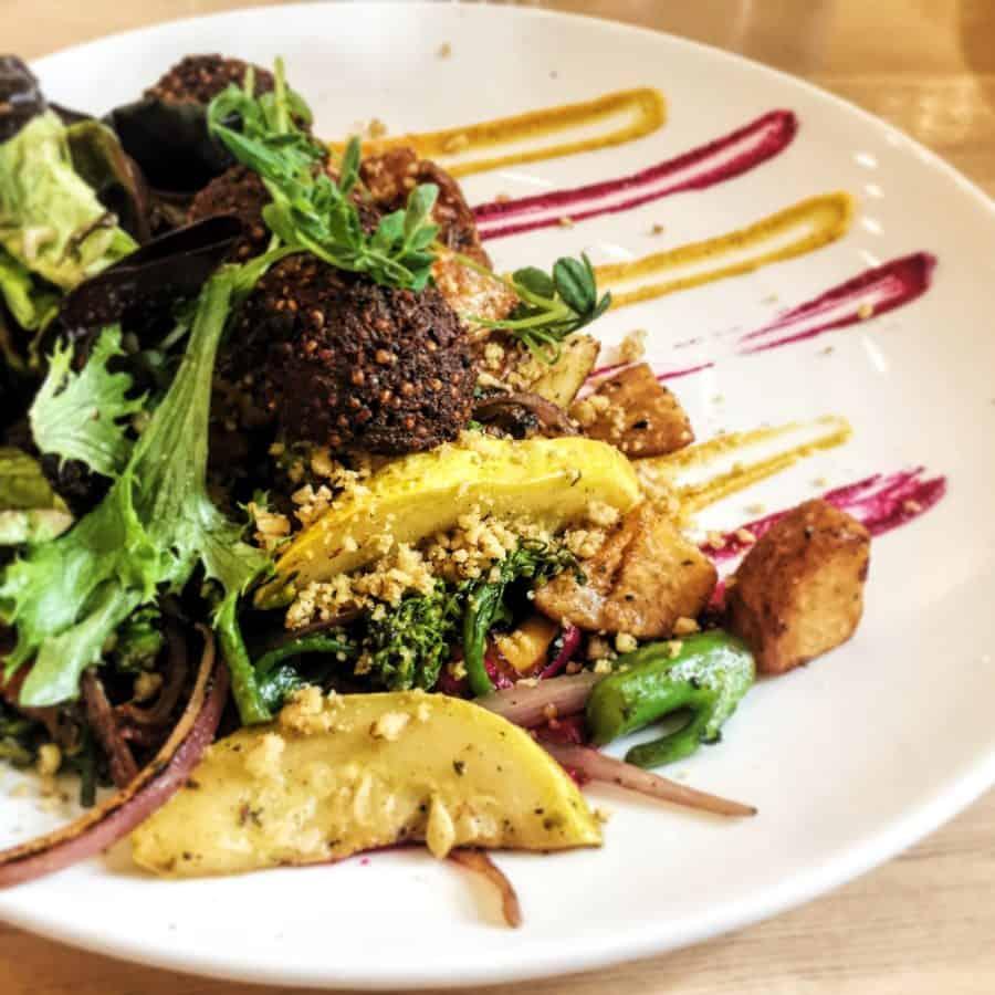Vegan Breakfast Hash with salad from Heirloom Vegetarian Restaurant in Vancouver.