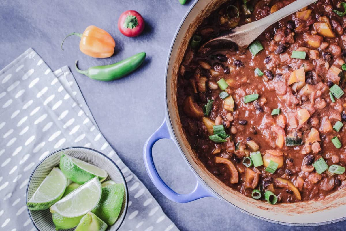 How to Vegan Meal Prep - image shows a large batch of vegan chili in a soup pan.