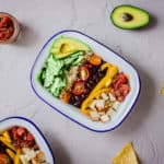 Overhead shot of Healthy Mexican Bowls with Salsa, surrounded by avocado and tortilla chips.