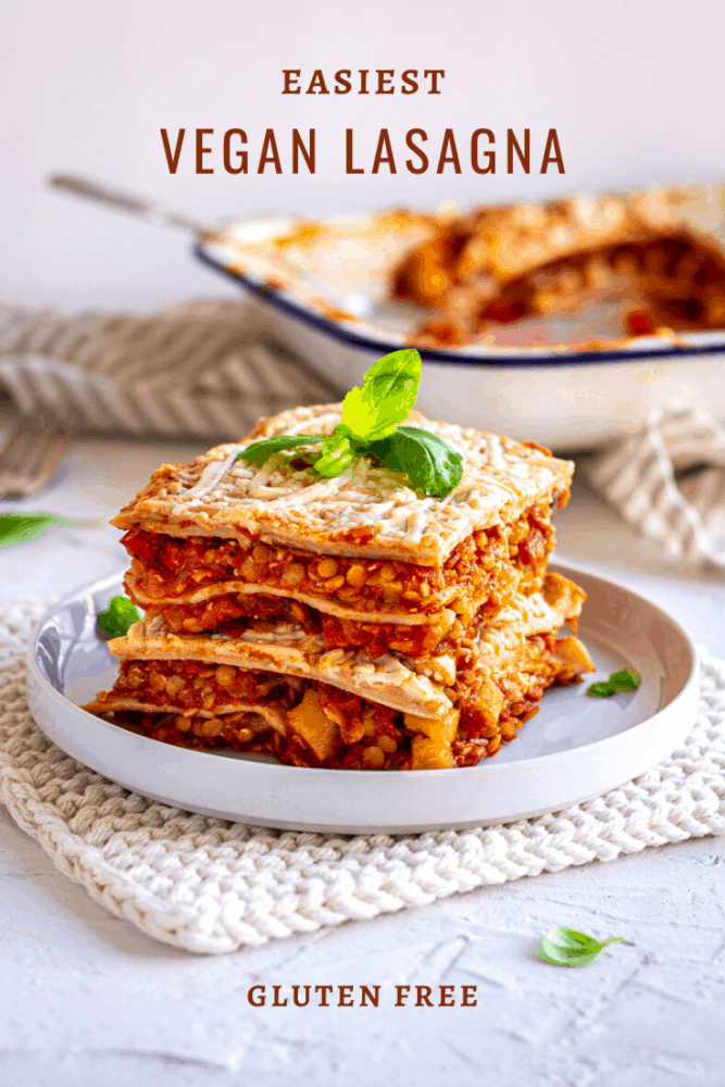 A delicious and simple vegan lasagna made with budget friendly red lentils, herby tomatoes and a creamy homemade 15-min cheese sauce. Perfect for cold fall nights when you want a warming dinner! Gluten free and nut free too. #lasagna #vegan #dairyfree #glutenfree #pasta #fall #dinner #nutfree #mealprep