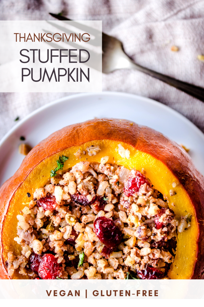 Looking for a centrepiece for your vegan Thanksgiving dinner? This delicious Stuffed Pumpkin recipe is packed with pecans, rice, cranberries and vegetables for a dinner that's bursting with flavour. Gluten free, with a nut free option too. #pumpkin #stuffedpumpkin #vegan #glutenfree #nutfree #thanksgiving #fall #pecans #cranberries