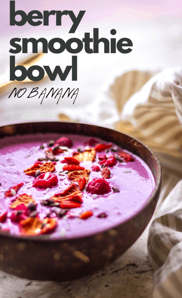 This berry smoothie bowl is vegan, dairy-free, and made with just 6 ingredients. It's a healthy breakfast that contains no banana and is sweetened with dates. #smoothiebowl #smoothie #smoothierecipes #vegan #dairyfree #berries #sugarfree #breakfast #healthy #veganuary