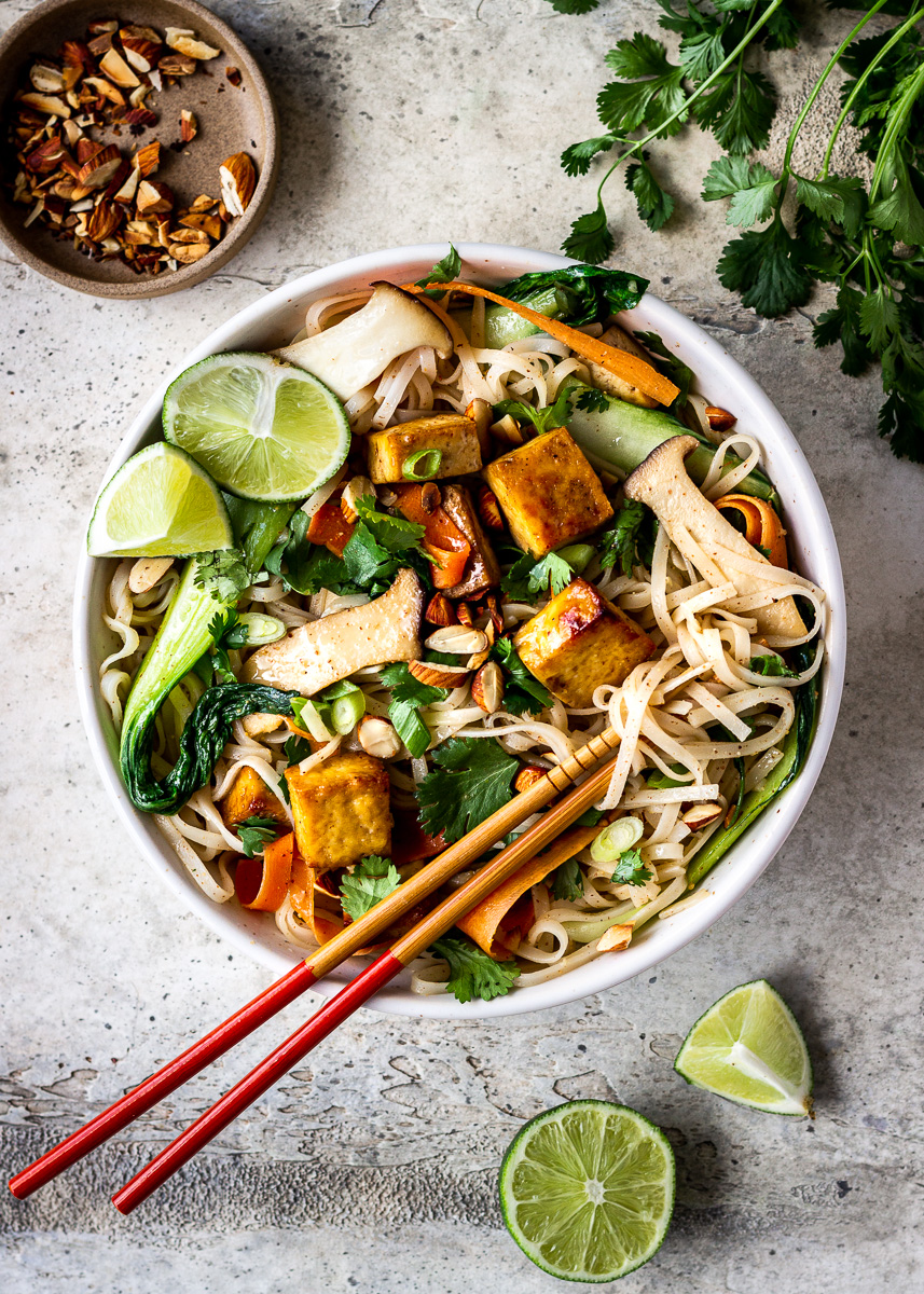 Overhead shot of tofu noodle bowl with mushrooms by Vancouver with Love