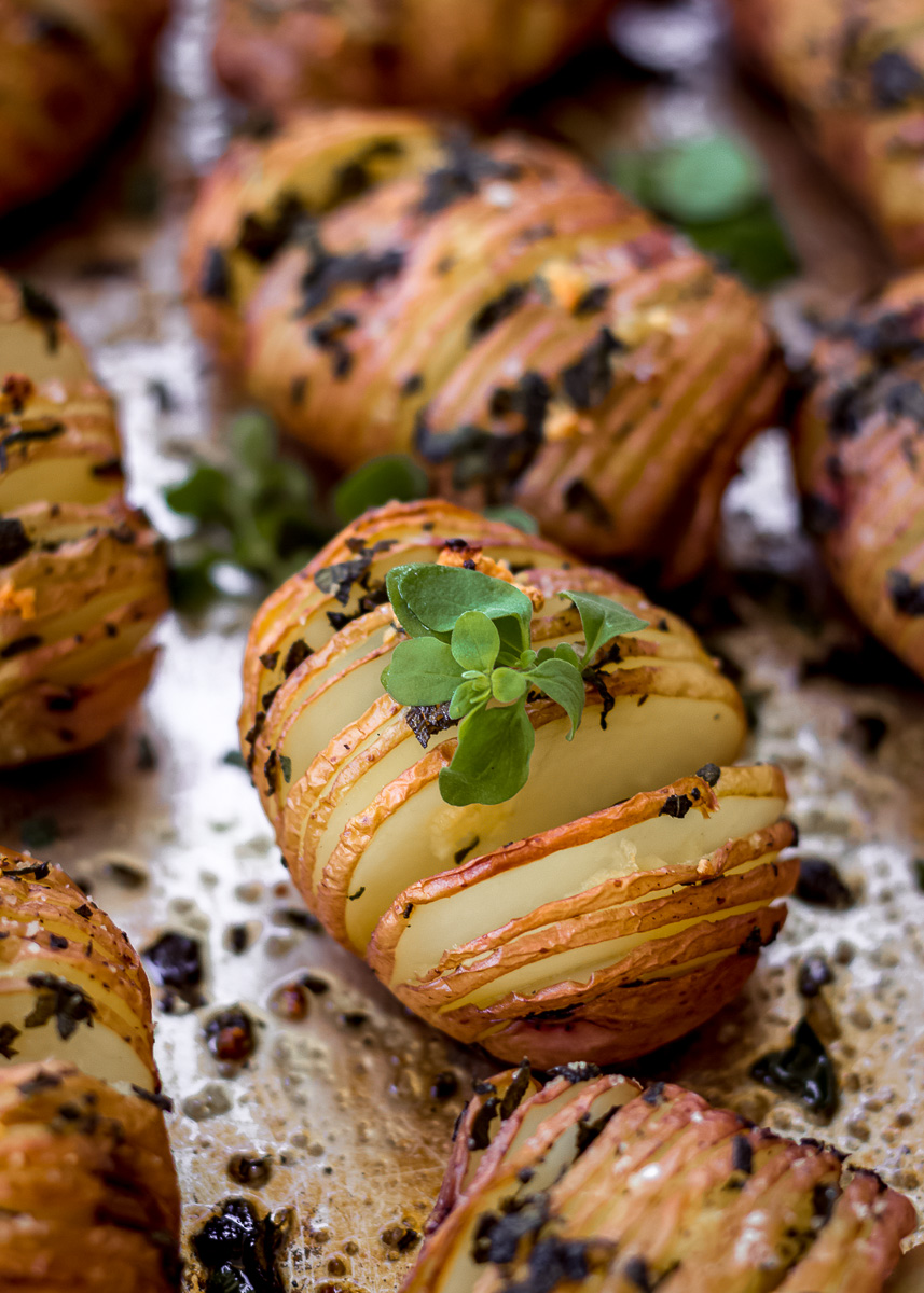 Close up shot of Sage & Garlic Hasselback Potatoes (vegan & gluten free) by Vancouver with Love