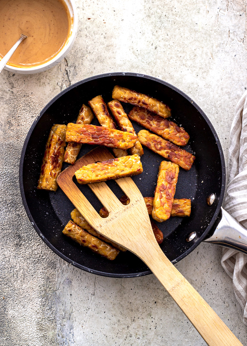 Tempeh cooking in a skillet by Vancouver with Love